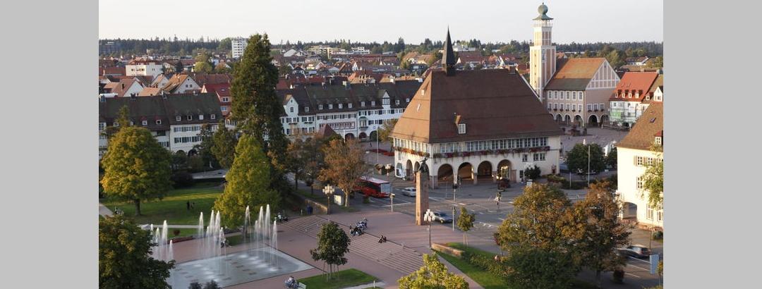 Stadthaus und Fontänen
