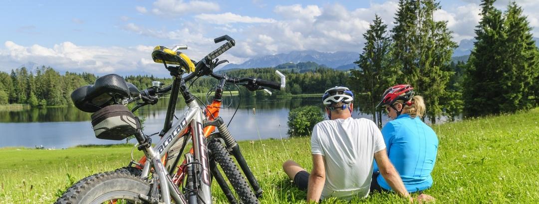 Bikers taking a break at a lake