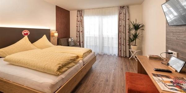 Hotel-Alpenfeuer-Montafon-Komfort-Doppelzimmer-Feu