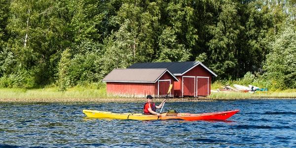 Kayaking close to Häyrylänranta harbour, Konnevesi