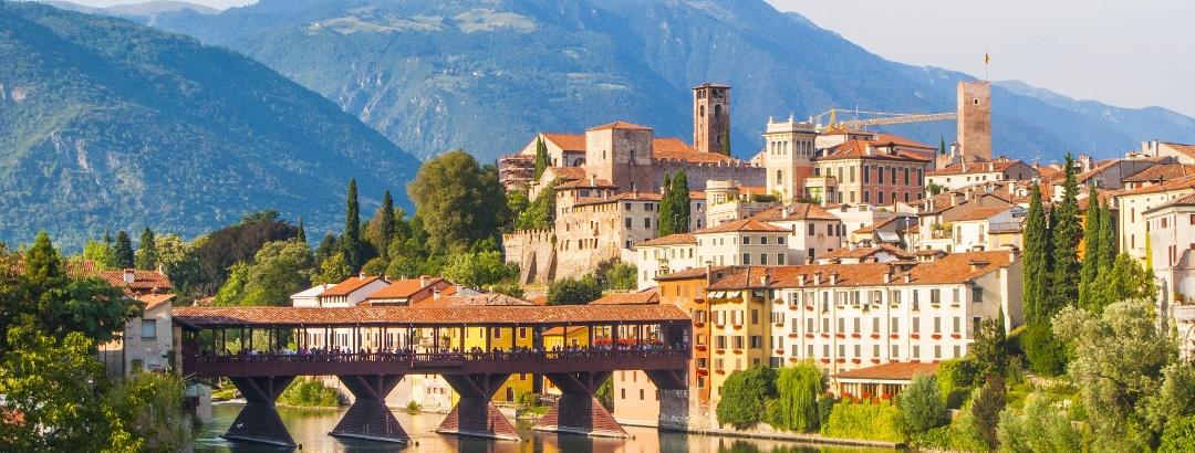 Old wooden bridge spans the River Brenta at the romantic village Basano del Grappa
