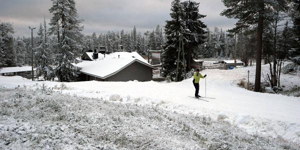 Skier on Ruka village First Snow Lit Trail, Ruka Ski Resort, Kuusamo
