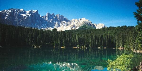 The Lago di Carezza lake at the feet of the Latemar mountain.