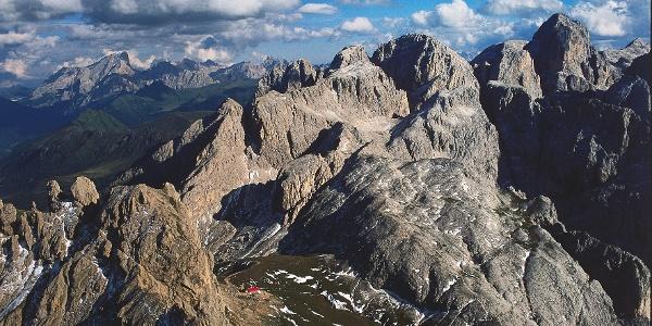 The Tires Haven in the Sciliar alpine zone. In the back the Molignon arrival point of the via ferrata.