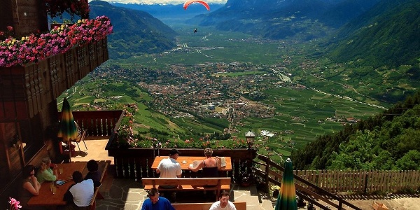 Guest enjoy a special view over the basin of Merano sitting on the sunny terrace of the Talbauer Mountain Inn.