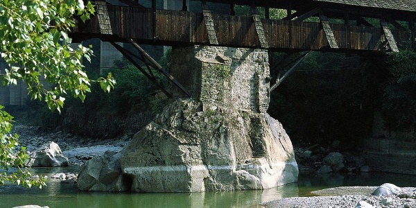 A historic bridge crossing the Eisack - Isarco river