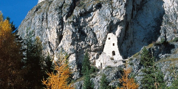 The ruin of Wolkenstein castle, a fortress built into the rocks.